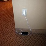 The only accessible outlet for cell phone number two or the iron.