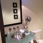 The beautiful sink, with the 'Bliss' soap and also lotion. The bathroom is very well decorated.
