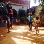 Hula hooping with the kids in the courtyard