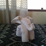 Little elephant welcoming at the room