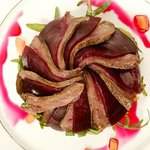 carpaccio of wood pigeon with beetroot and rocket