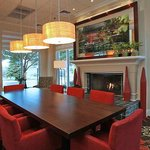 Modern lobby and comfortable dining area at Hilton Garden Inn Chesteron, IN hotel