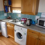 Clean, modern kitchen, with washing machine - very handy