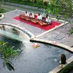 A Gamelan band plays by the pool
