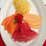 Mixed fruit plate as part of breakfast