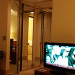 TV next to bed & pivots to see easily from each seat in room. Closets w/nice mirrors. No robes w
