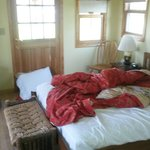Room with queen bed in family cabin