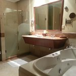 bathroom with seperate shower cubicle and jacuzzi bath