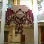 weaving hanging in central hall of Capitol building, Santa Fe