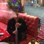 Smoking a shisha at the restaurant outside the hotel.