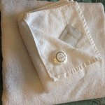 Fresh clean towels with soap and shower gel