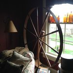 Spinning wheel decorating the parlor