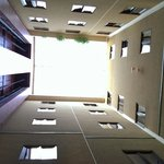 Looking up from the dining room at the elevators and guest rooms above