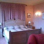 A huge bed from the suite which includes a huge attractive bathroom & sitting room area.