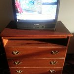 Antiquated TV and worn out dresser