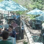 Several outdoor tables adjacent to the creek area.