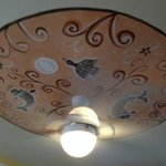 Every room has a custom painted ceiling w/ fan