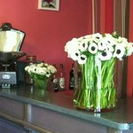 Beautiful fresh cut flowers on the bar in the reception area