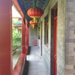 Hallway and rooms open to a central courtyard and koi pond
