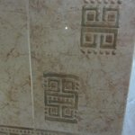 Bathroom tiles decorated with Mayan hieroglyphs