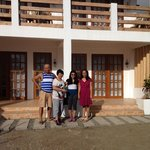 With the owners at their newly built beach front hotel.