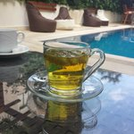 Chilling with a green tea near the swimming pool