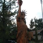 There are a couple large wood carvings outside