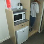 Microwave and Fridge with adjacent storage