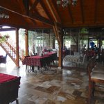 View of reception, breakfast/dining, pool area. Very pleasant and relaxing.