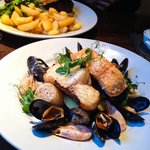 Fish grill of seabass, salmon, cod, prawns, muscles, scallops and boiled potatoes. Wonderfully c