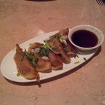 Asian dumpling with soy dipping sauce.