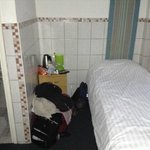 No room for luggage, it's next to the bed; bathroom on the left