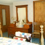 Blue room with a queen bed and a twin bed