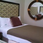 Wall mirror and queen bed