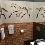 Bathroom with wall art