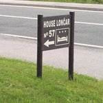House Loncar  -Sign on Road to the House
