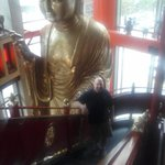 My boyfriend next to the giant buddha statue