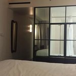 Panoramic view of suite.  Glass partition/window into bathroom (ADA)