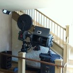 An old timey movie projector greets you