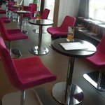Chairs and tables in the bar area