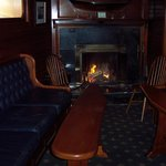 The cozy fireplace in the downstairs pub