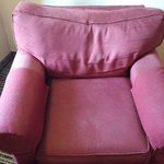 Worn but comfortable chair in room
