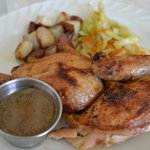 Grilled half-chicken with herbs
