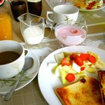Strawberry yogurt, juice, fresh fruit and french toast delivered to the table