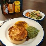 This is how I like it. Mash, gravy, cheese, a little bit of peas and salad. With the best pie ev