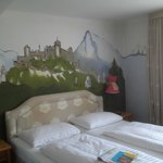 View of beds and mural on the wall