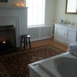 The Jacuzzi and fireplace in the bathroom