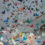 A cascade of 4000 origami cranes that filled a four storey stair well.
