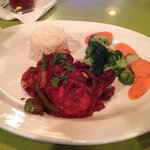 "My husband's dinner entree- Smoked Red Hot Chicken with Basmati Rice. (At the ""Elephant Walk"" re"