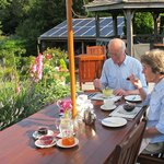 Guests enjoying breakfast on the patio